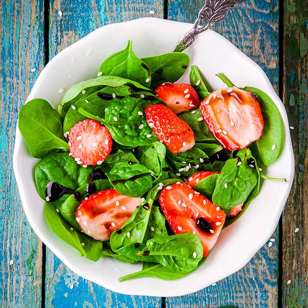 Healthy and delicious salad with strawberries